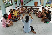 Teacher in front of class of kids